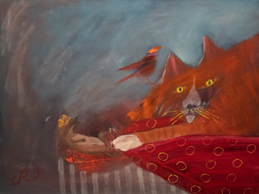 cat on red pillow